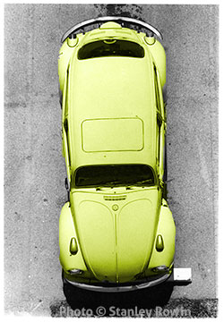 Aerial photo of a yellow Volkswagen Beetle Bug