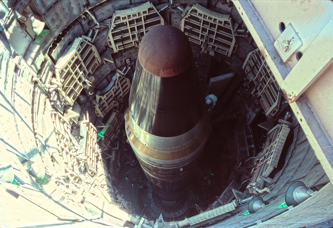 Warhead atop 103-foot (31 m) Titan II missile, inside silo