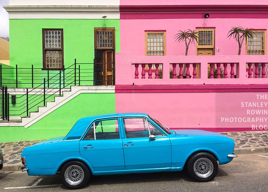 Blue car with brightly painted houses, Bo Kaap, Cape Town South Africa