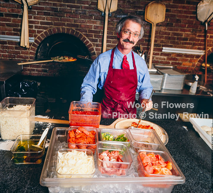 Woodie Flowers making a pizza