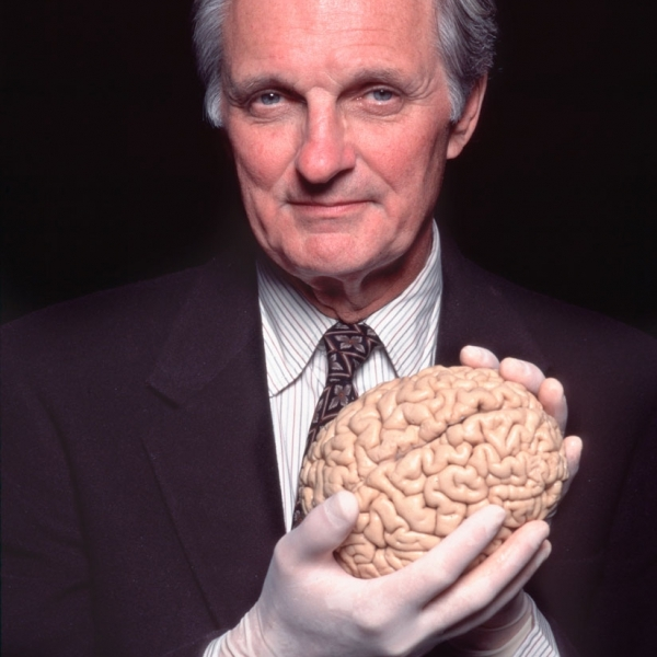 Alan Alda Holding a Human Brain for Scientific American/Frontiers