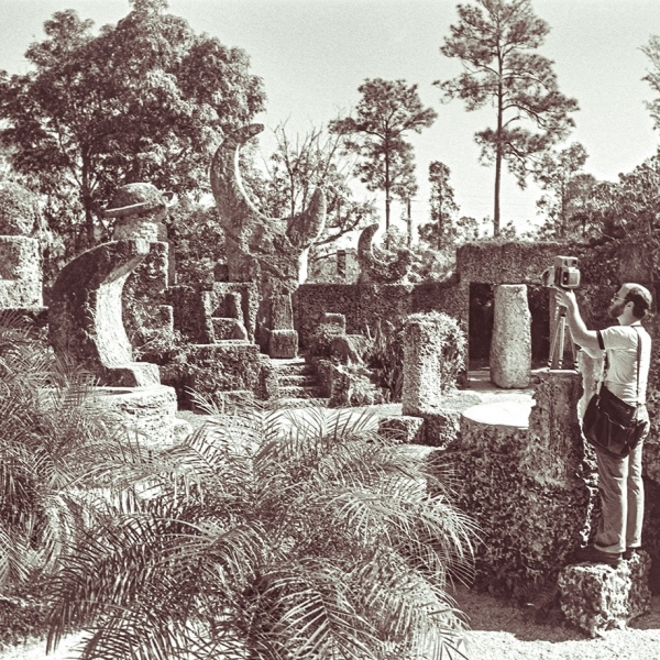 Man photograping in a coral castle or lunar landsacpe