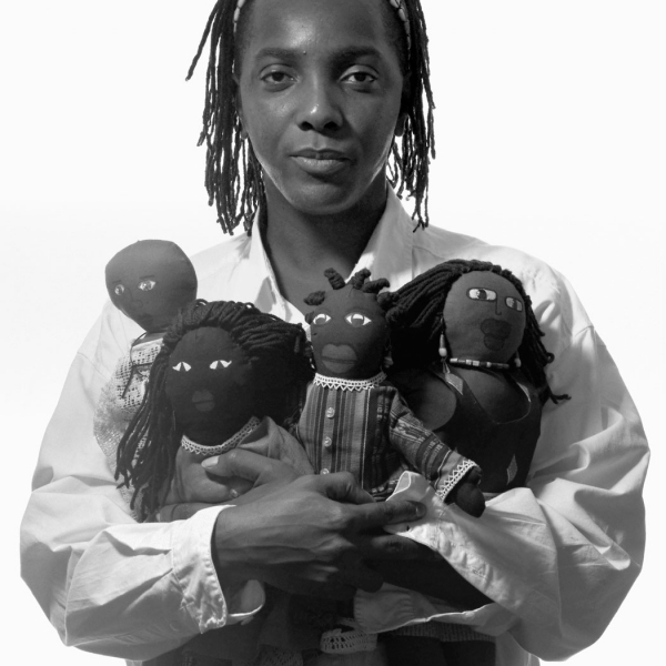 Man with Doll Collection